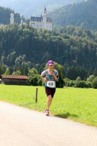 Königsschlösser Romantik Marathon - Schloß Neuschwanstein im Hintergrund